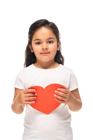 cute latin kid holding red heart-shape carton isolated on white Stockfoto