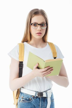 shocked schoolgirl with backpack holding book isolated on white