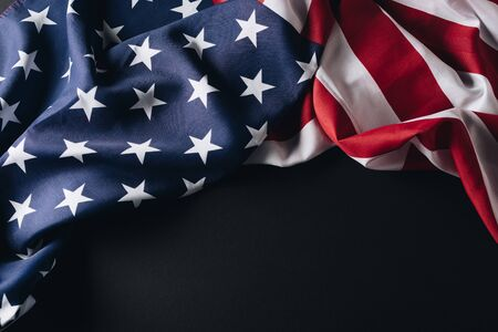 folded national flag of america isolated on black, memorial day concept