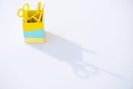 pencil box with scissors, pen and pencil on white background Stockfoto