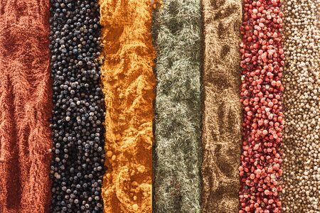 top view of traditional bright indian spices in rows