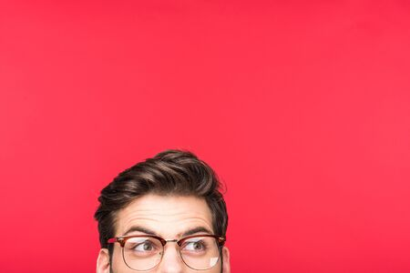 Handsome man in glasses looking away isolated on pink background with copy space Stok Fotoğraf