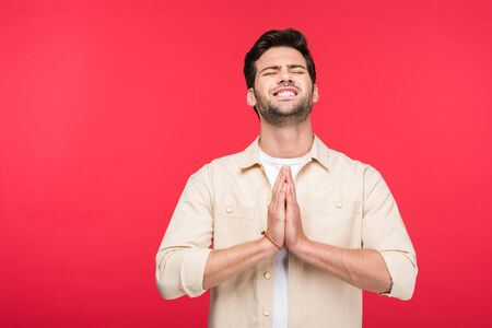 Handsome man doing please gesture isolated on pink background