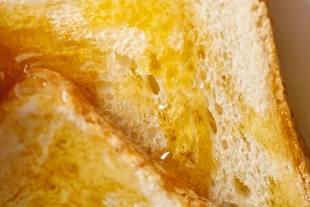 Close up view of toasts with honey