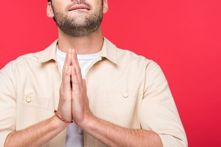 Cropped view of man doing please gesture isolated on pink background
