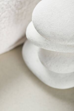 Close up view of stones in stack near white cotton towel
