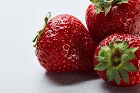 Close up of red sweet strawberries on white background