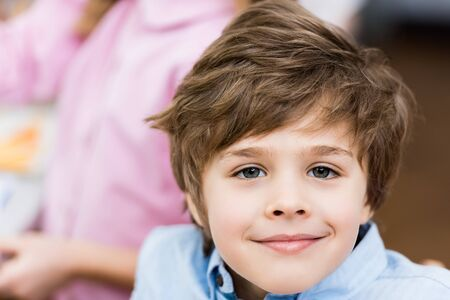 Close up of cheerful child smiling while looking at camera