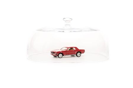 Toy car under glass cloche isolated on white background Stok Fotoğraf