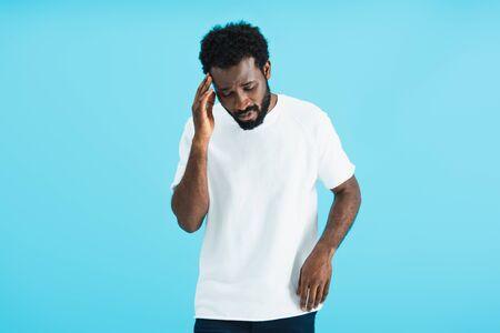 african american man having headache isolated on blue