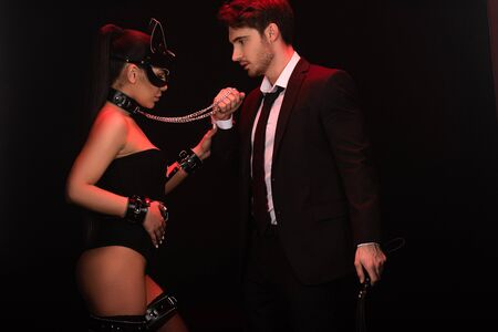 Sexy bdsm couple with handcuffs isolated on black background Stock Photo