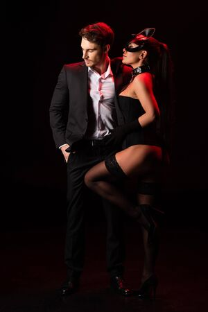 Full length view of couple on black background