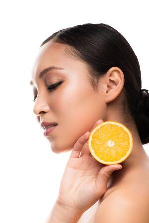 Beautiful Asian girl holding orange, isolated on white background