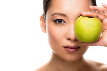 Beautiful Asian girl holding green apple, isolated on white background Stock Photo