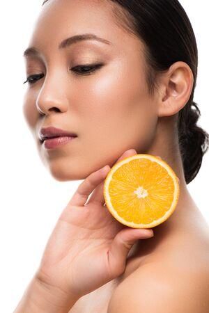 Beautiful Asian woman holding orange, isolated on white background