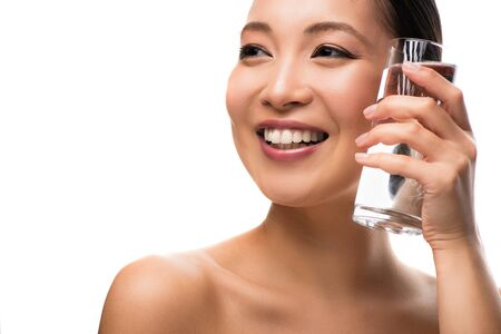 Beautiful smiling woman holding glass of water, isolated on white background