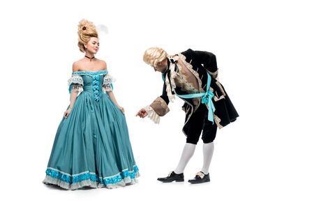 handsome gentleman bowing down near victorian woman in blue dress isolated on white