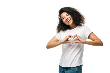 happy african american girl showing heart with hands isolated on white Stockfoto