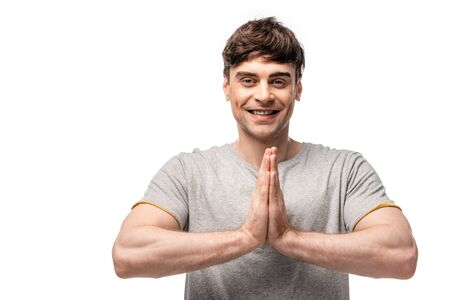 smiling handsome man showing please gesture while looking at camera isolated on white