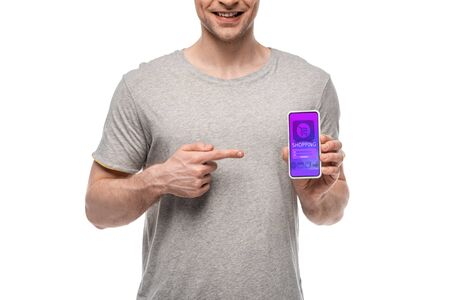 cropped view of man pointing at smartphone with shopping app, isolated on white 写真素材
