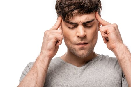 exhausted man suffering from migraine and touching head with fingers isolated on white