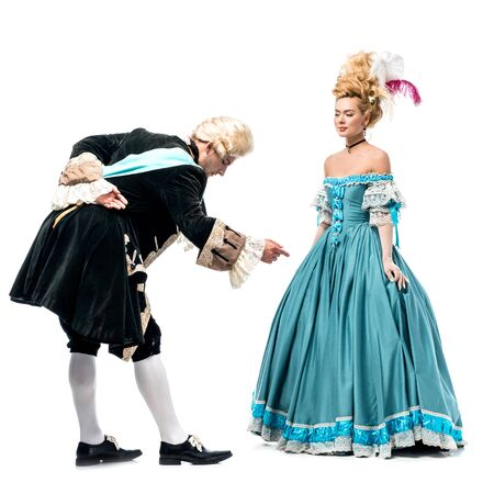 handsome gentleman bowing down near beautiful victorian woman in blue dress isolated on white 스톡 콘텐츠