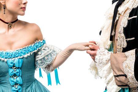 cropped view of gentleman holding hands with victorian woman in blue dress isolated on white