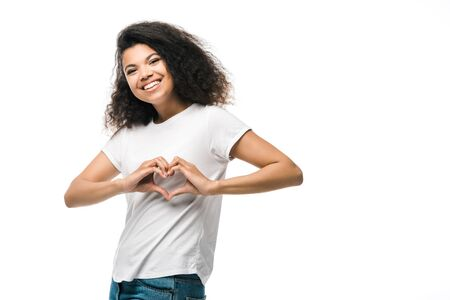 cheerful african american girl showing heart with hands isolated on white