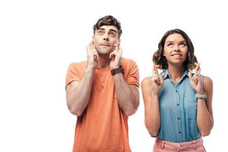 young man and woman looking up while holding crossed fingers isolated on white Stok Fotoğraf