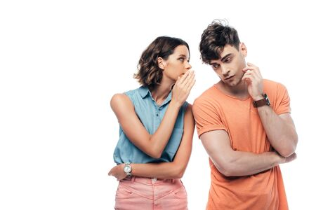 attractive young woman whispering to thoughtful man isolated on white