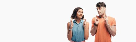 panoramic shot of young and woman holding crossed fingers and looking at each other  isolated on white Stok Fotoğraf