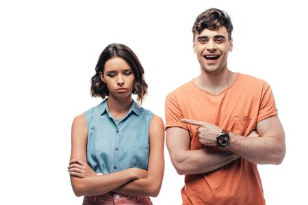 cheerful man pointing with finger at offended young woman isolated on white Stockfoto