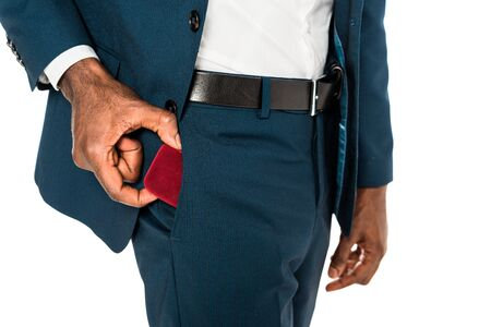 cropped view of african american man putting red box in pocket isolated on white 版權商用圖片
