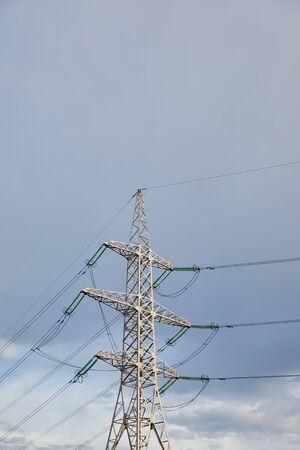 low angle view of electric pole with wires on grey cloudy background