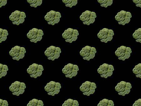 green organic whole cauliflower isolated on black, seamless background pattern