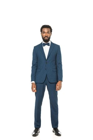 handsome african american bridegroom standing in groom suit isolated on white