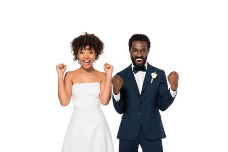 excited african american bridegroom and bride gesturing isolated on white