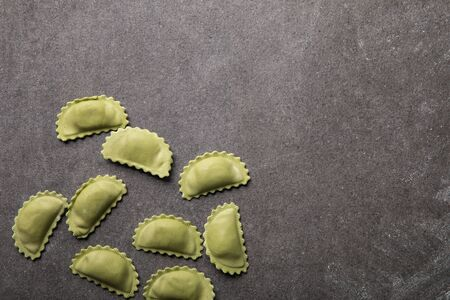 top view of green raw ravioli on grey textured surface with copy space 版權商用圖片