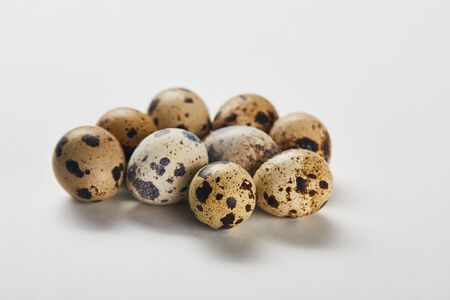 few small quail eggs on white surface Stok Fotoğraf