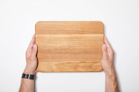top view of man holding wooden chopping board on white background