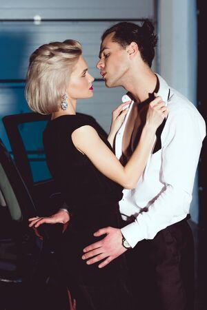 beautiful seductive woman undressing handsome man