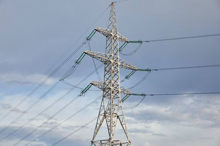 low angle view of electric pole on grey cloudy background