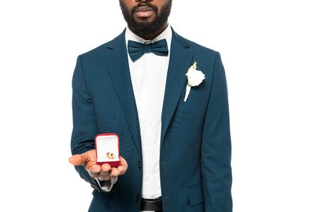 cropped view of bearded african american man holding box with wedding ring isolated on white 版權商用圖片