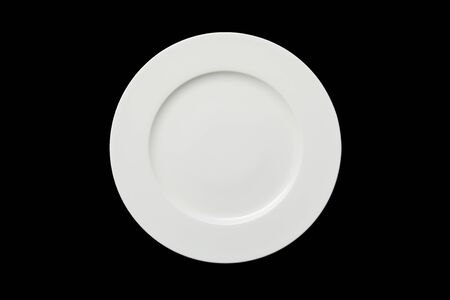 top view of white empty round plate isolated on black