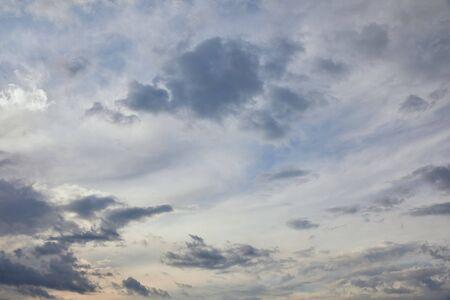 blue clouds on blue sky background and sun rays Reklamní fotografie