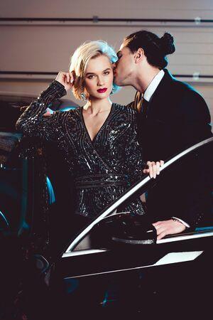 128145030-stylish-man-kissing-beautiful-seductive-woman-near-car.jpg?ver=6