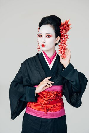 beautiful geisha in black and red kimono isolated on white Stock Photo
