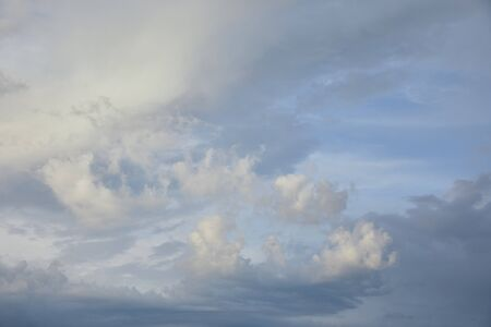 view of white and grey clouds on blue sunlight sky background