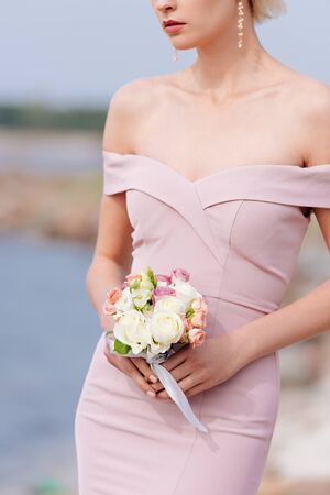 cropped view of elegant woman in pink dress holding bouquet Stok Fotoğraf