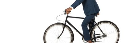 panoramic shot of african american bridegroom riding bicycle isolated on white Фото со стока